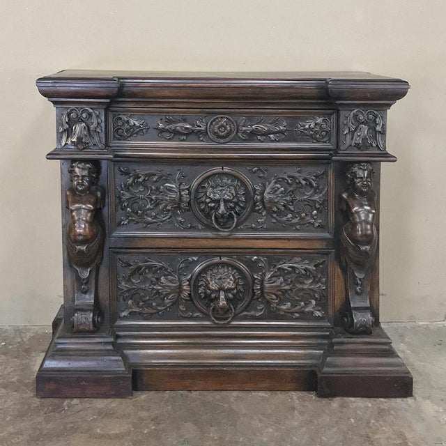 19th Century Italian Renaissance Commode is resplendent with sculpted figures, lions' heads and elaborate foliate in...