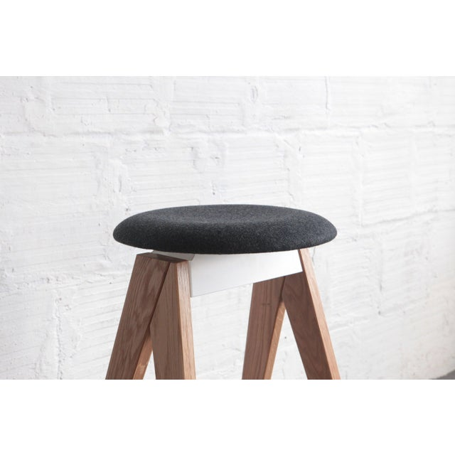 Utilizes folded metal and wood, floating top, lightweight, portable. So-named, the side profile of this stool resembles a...