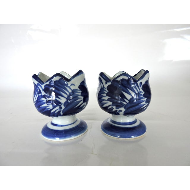 Pair of pretty blue and white hand painted pottery candle or tea light holders - fits both. Hand painted in Vietnam - leaf...