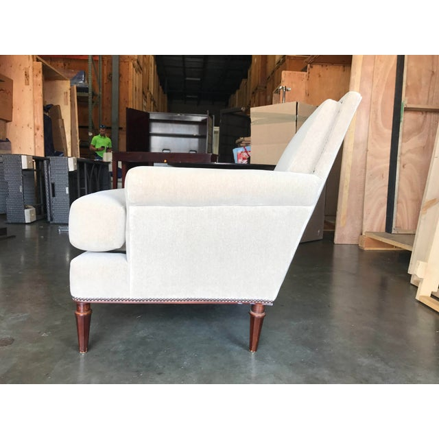 Modern and classic armchair, elegant shape and size great for office or bedroom. upholstered in light greyish beige...