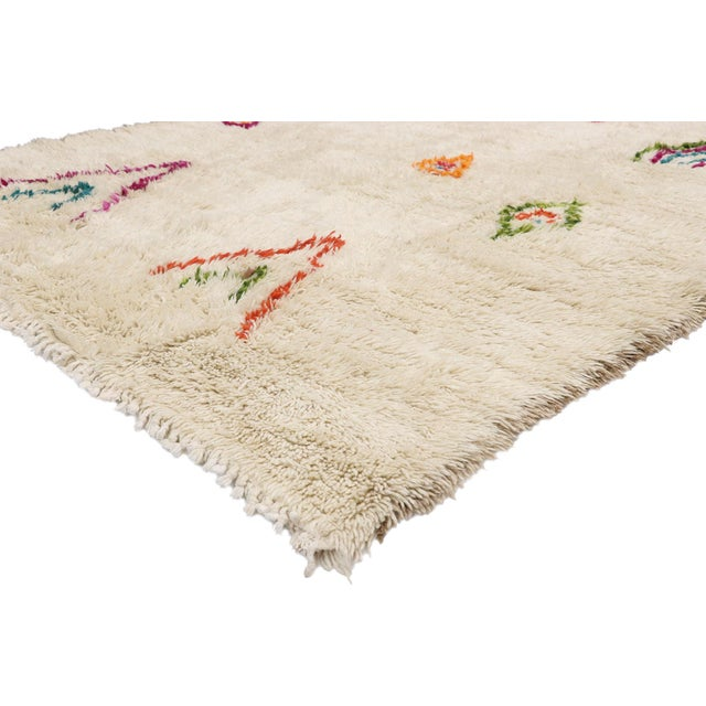 21036 Contemporary Berber Moroccan Azilal Rug with Cozy Hygge Boho Chic Tribal Vibes 06'08 x 08'00. This hand knotted wool...