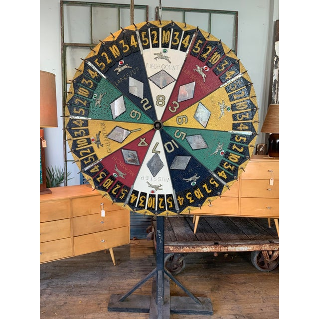 A stunning antique Folk Art horse race betting spinning wheel, circa 1930s handmade with beautiful graphics and design and...