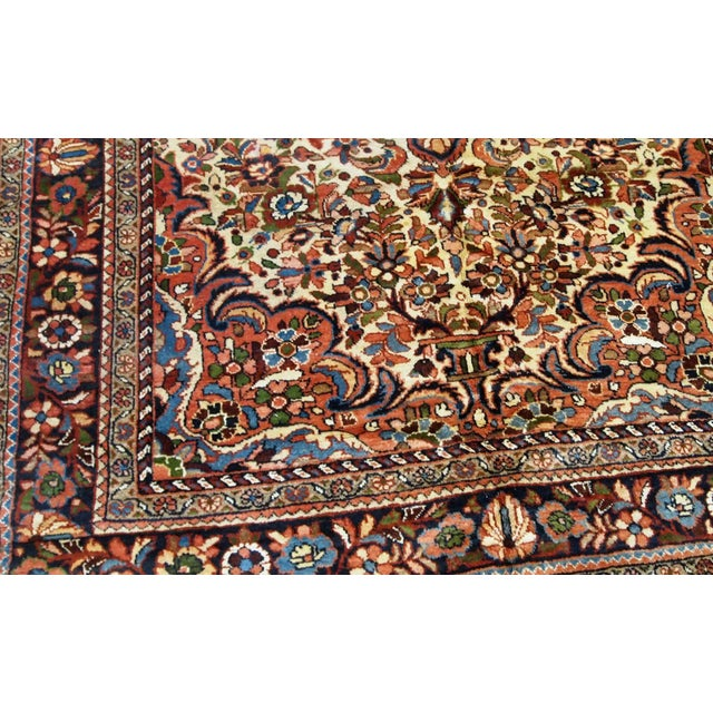 Hand made antique Persian Sarouk rug in beige wool. The rug is from the beginning of 20th century in original good condition.