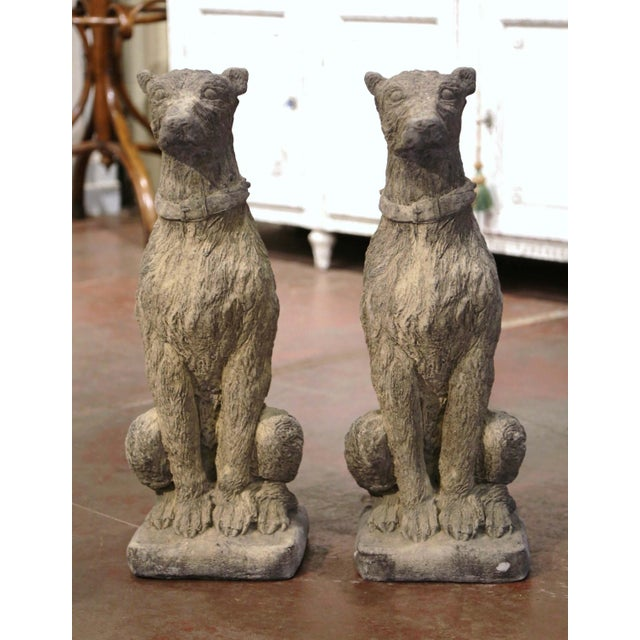 Carved of stone circa 2000, the tall vintage deerhounds are set on a flat square base; sited on their back legs, both...
