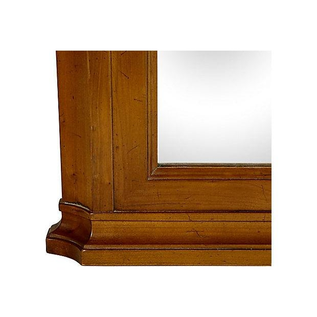 1960s cherry wood wall mirror designed by Kindel Furniture Co in the Belvedere finish. Marked. Hardware is not included.