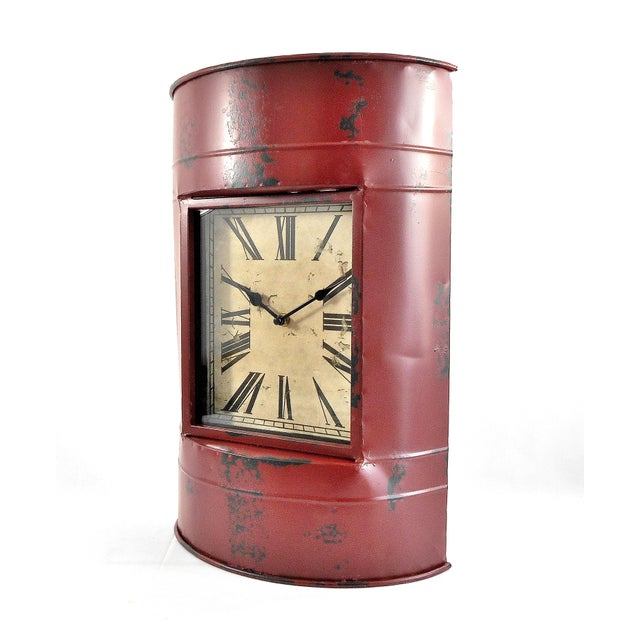 This clock is made to look like it was crafted from an old metal barrel. Has a wonderful distressed red finish! It can be...