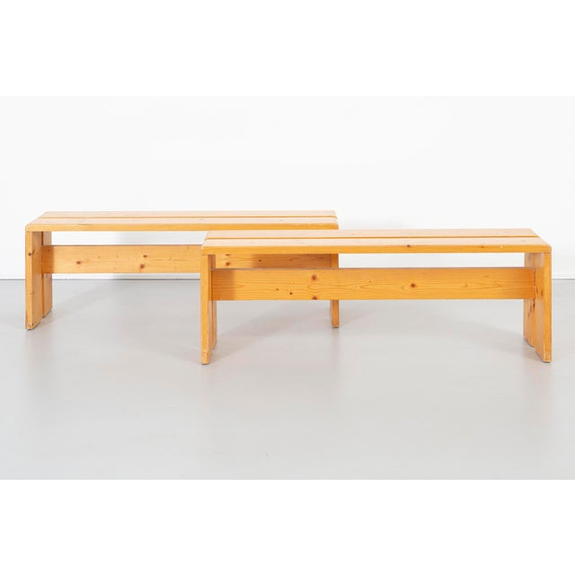 A set of two benches that are part of a dining table set designed by Charlotte Perriand for Les Arcs in France, c 1968....