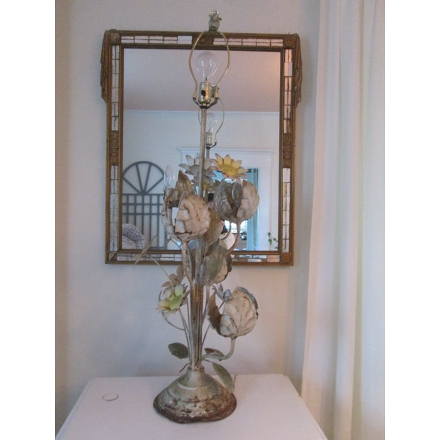 The seller says: This large scale floral toleware style table lamp is highly distressed and rusted out for a rustic garden...