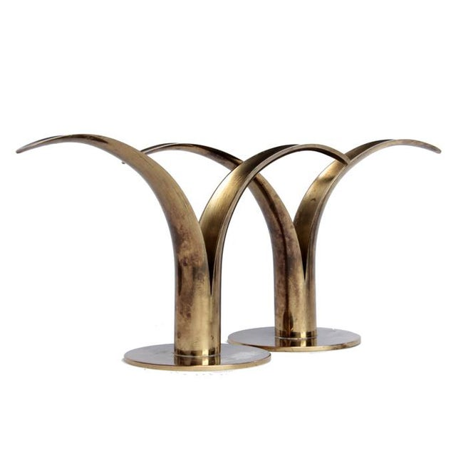 Add some Scandinavian flair to your tabletops with this beautiful pair of iconic brass candlesticks designed by Ivar...