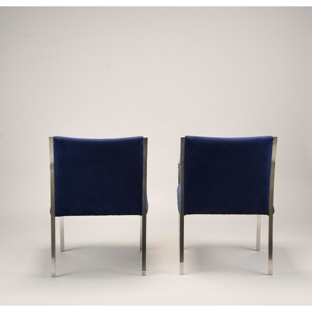 Circa 1970s pair of polished steel frame arm chairs designed by Bert England for Stow Davis. Newly upholstered in royal...