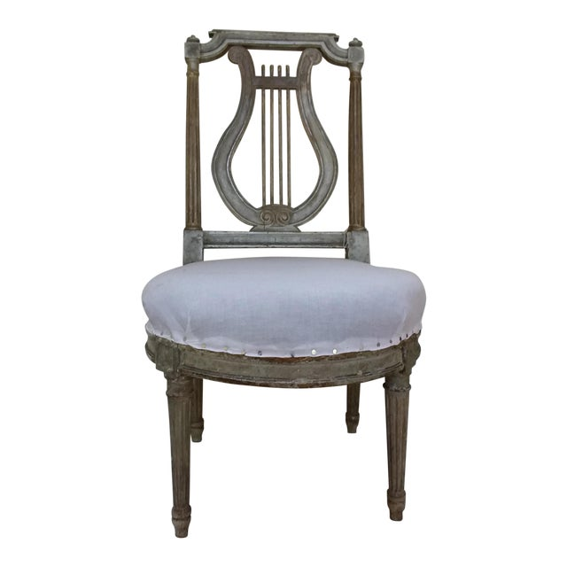 """Lyre-back antique French Chair from the early 19th-C. With worn painted surface. Seat Height is 15."""""""