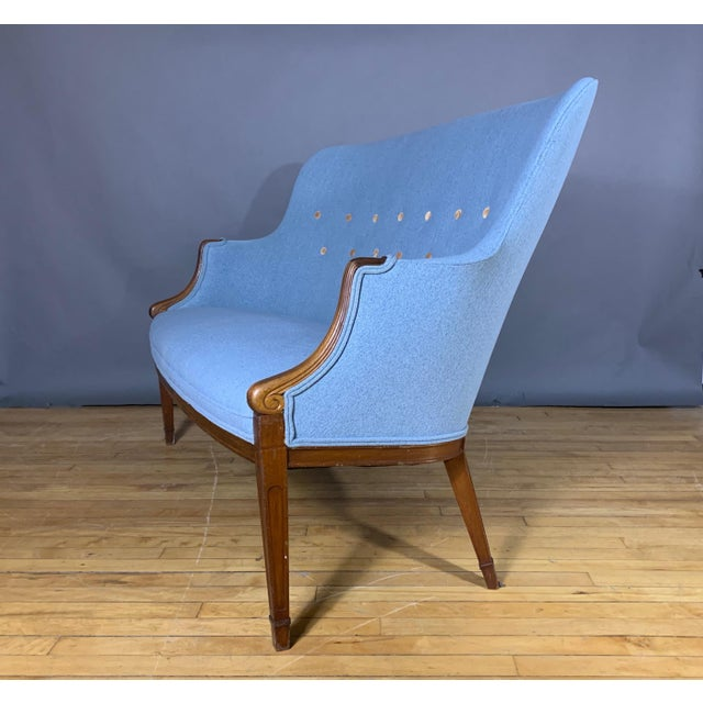 A classic designed two-seat settee by the outstanding cabinetmaker Frits Henningsen - first introduced in the 1940s with...