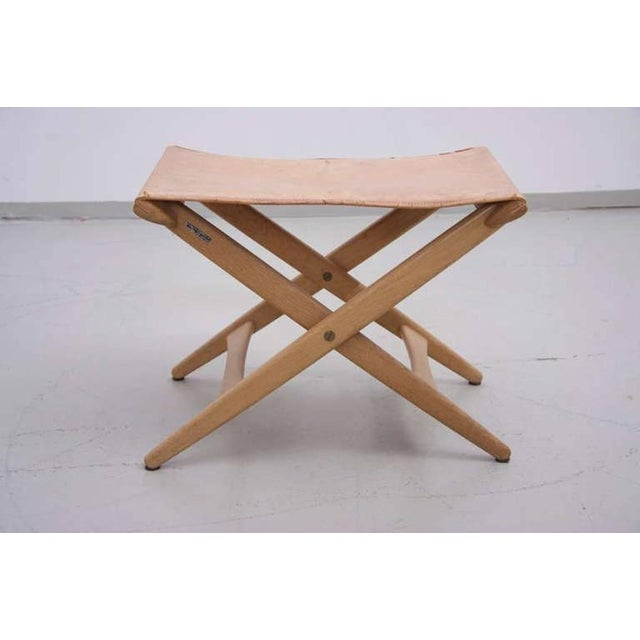 Luxus Vittsjö folding stool in original vintage condition with natural leather cover on solid oak