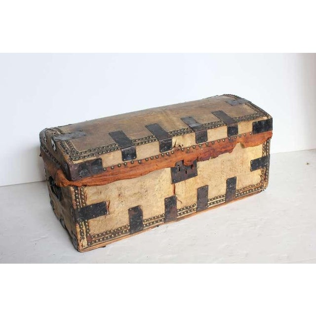 Great decorative leather trunk with iron and brass hardware.