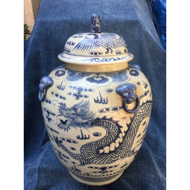 Fantastic large Chinese hand painted ginger urn featuring a fierce mystical dragon that wraps around the entire urn....
