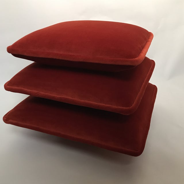 Vintage triple stacked cushion or Turkish style ottoman with red velvet upholstery. Top cushion rotates to reveal the...