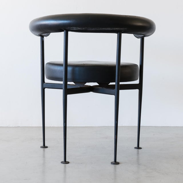 A graceful, French modernist desk chair in nicely patinated leather and blackened steel, France, 1950s.
