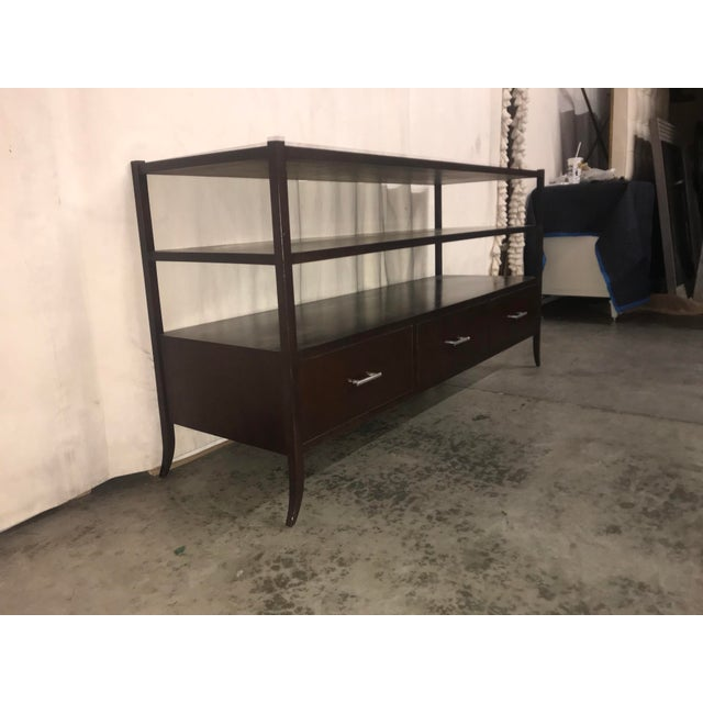 Versatile espresso stained console with three drawers