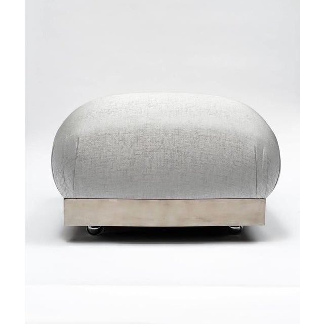 Gorgeous Hollywood Regency ottoman with iconic soufflé design and oversized features. Pouf has large square cushion with...