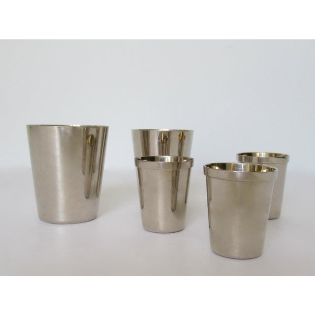 C. 1910-30's; German, silver plate, with interior gold lined, Gentleman's traveler's cups and cordials. There are a set of...