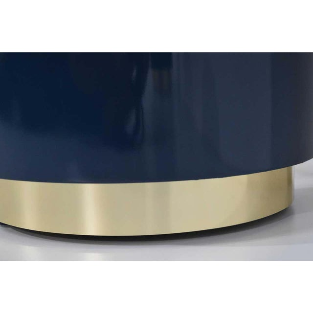 Beautiful console by Jay Spectre or Karl Springer that we lacquered in blue and updated with new brass trim.