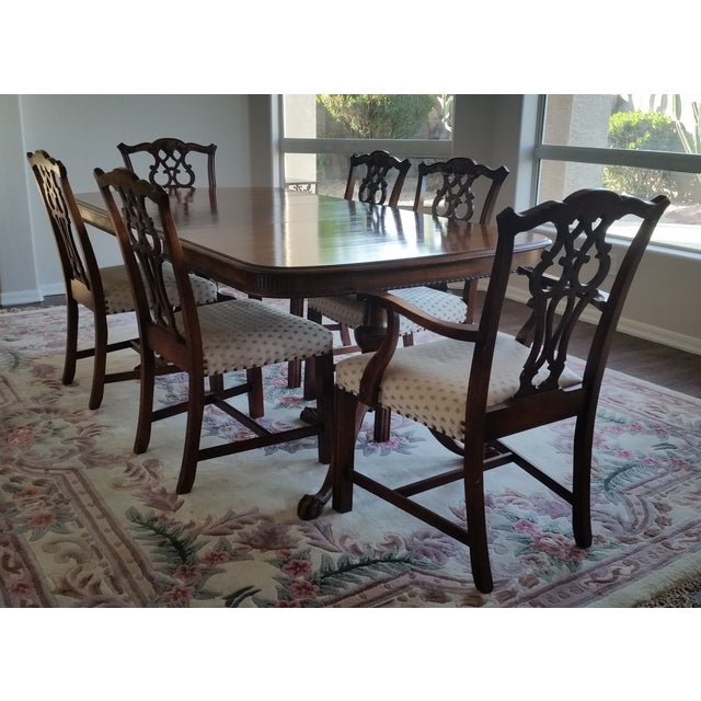 Antique Bernhardt dining table with six chairs and what makes this gorgeous set so special is that it belongs to a woman...