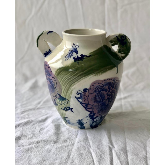 This large porcelain vessel is thrown in a classic urn shape with my signature flattened handles added. It is decorated...