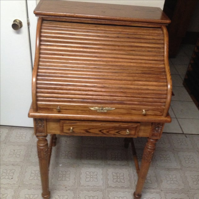 Vintage roll top secretary desk, oak wood, with lock brass handles by Eagle Craft. Some repair and minor scratches. It...