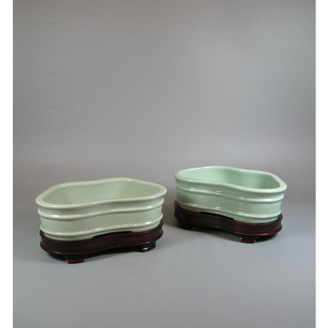 Up for sale is a very rare and unusual pair of antique Chinese pale celadon glazed porcelain bowls / planters for...