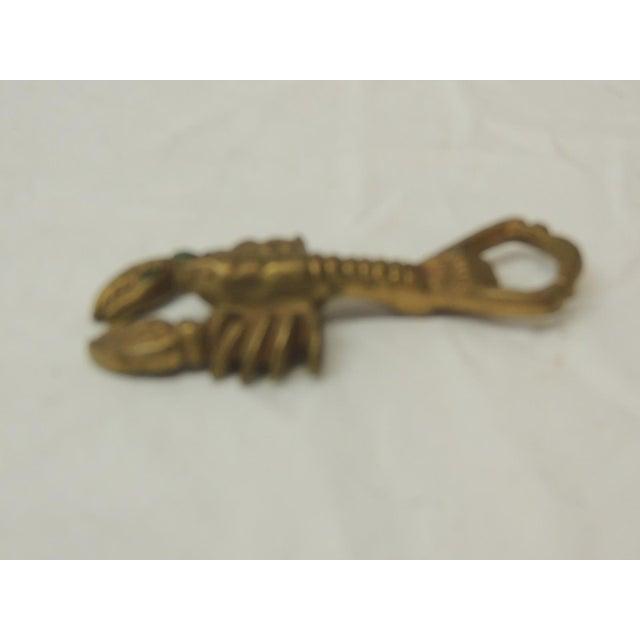 """Vintage brass bottle opener in shape of a lobster. Size: 4.75"""" x 2.75""""."""