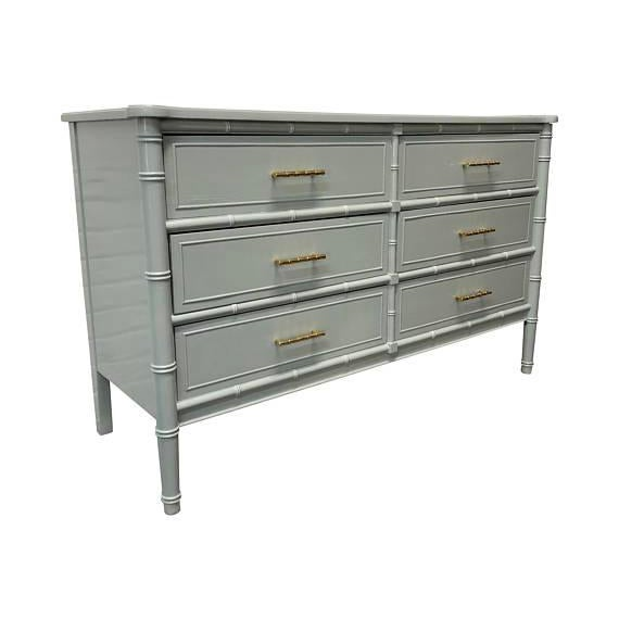 This piece was finished in Benjamin Moore's Piedmont Gray with a gloss finish. New Rejuvenation bamboo brass pulls were...
