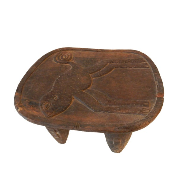 Superb and rare to find Senufo milk stools with heavy, tapered legs and an abstract form. carved with Chameleon on the...