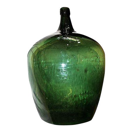 Here's a cool apple-shaped large antique French demijohn wine or oil bottle, all handblown with no seams.
