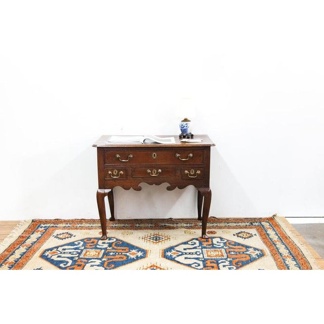 Up for sale is a 1730s English Four Drawer Dressing Table with Original Brass Hardware and Slipper Feet Weight: 50 lbs...