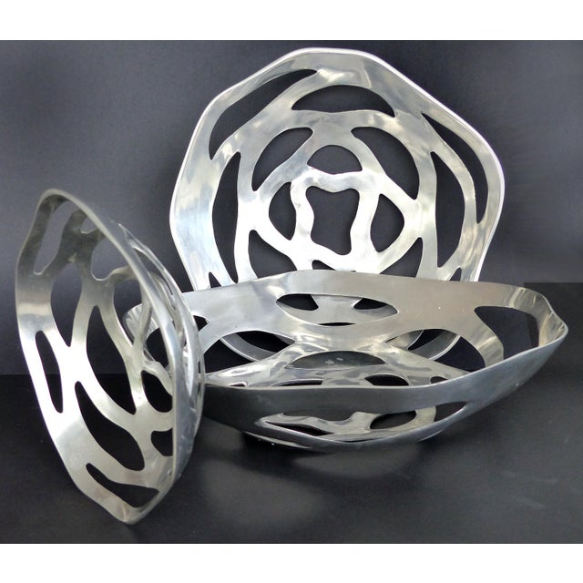 Offered for sale is a set of 3 large sculptural polished aluminum bowls. These elegantly designed bowls are graduated in...
