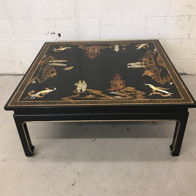This 1970s cocktail table is brought to us by its original owner and is gorgeous. The top has been preserved by a glass...