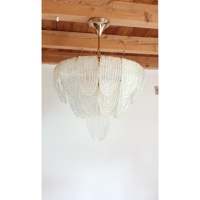 Mid-Century Modern translucent & textured Murano glass chandelier, with gold plated frame. One available. Can be hanged as...