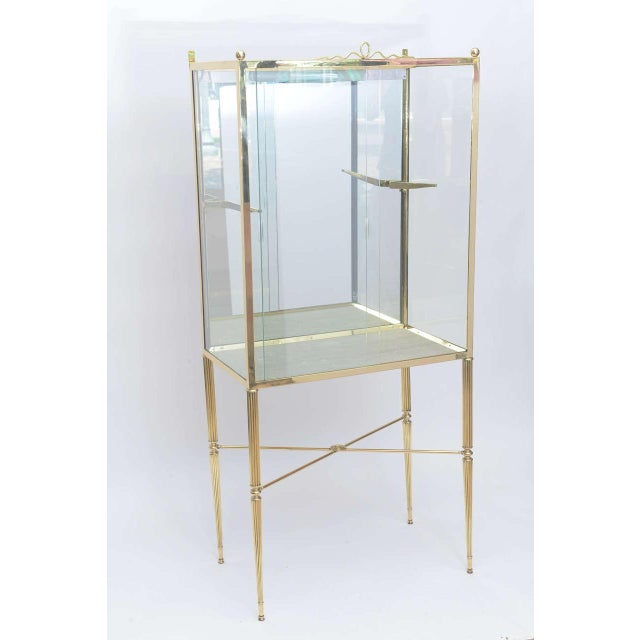 Beautifully designed display cabinet in brass and glass with adjustable single shelf not shown very much in the manner of...