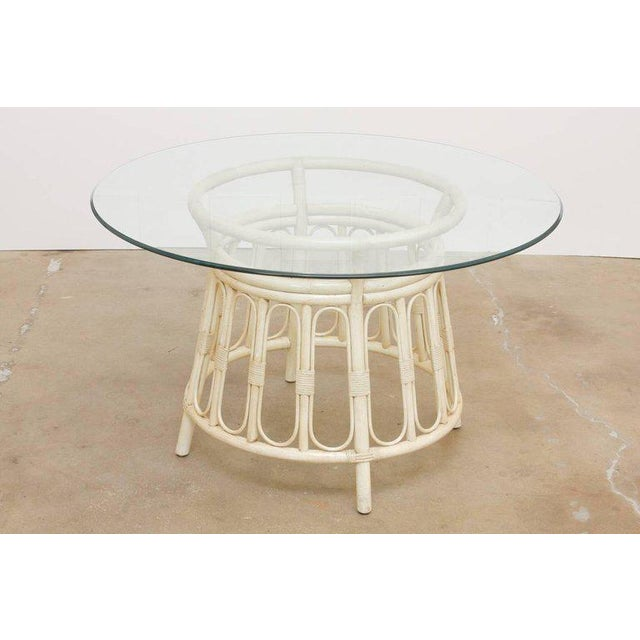 Stylish bamboo and rattan lacquered dining or patio table by Brown Jordan. Features an hourglass shape basket design base...