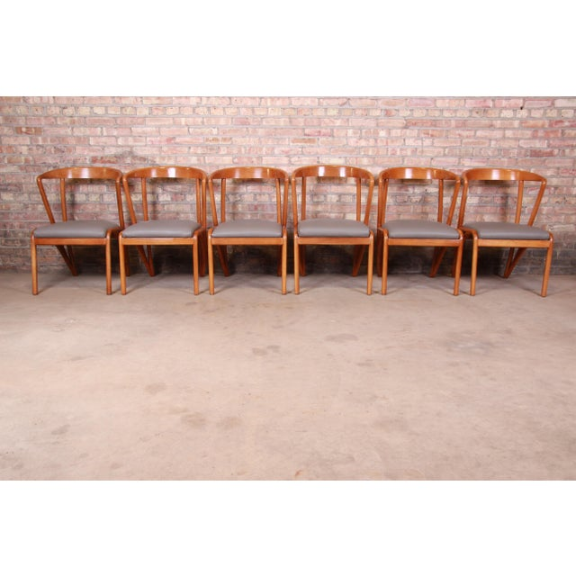 A gorgeous set of six mid-century modern style dining chairs In the manner of Bertha Schaefer By Baker Furniture USA,...