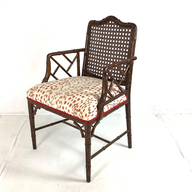 Set of 6 stunning faux bamboo chairs with amazing upholstery. Frames are carved hardwood with a lovely painted faux bois...