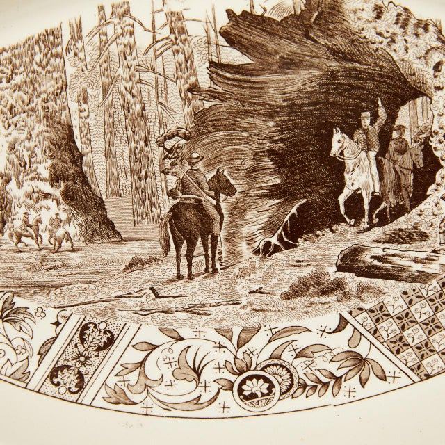 This ironstone platter has a transfer print of Yosemite with men riding horses through a redwood tree. The print also...