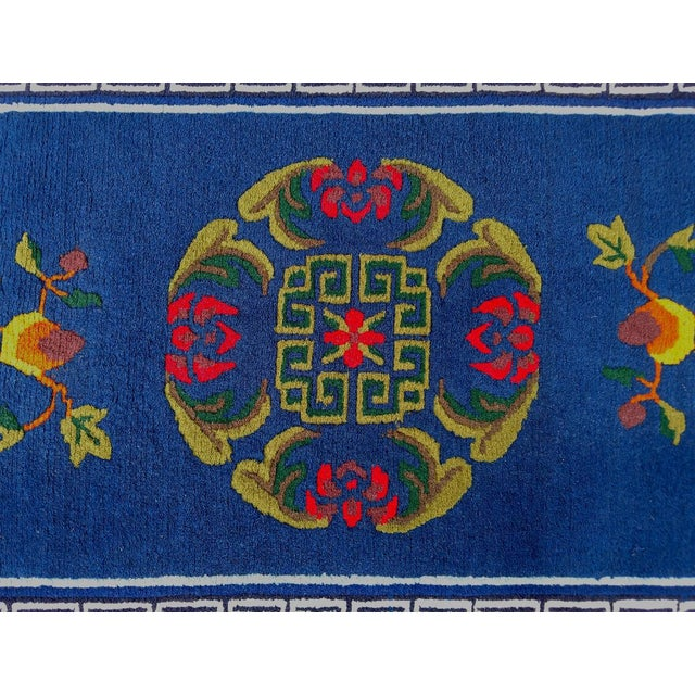 This is a beautiful hand-knotted Asian-inspired wool rug with vibrant colors. The pattern is traditional yet fun, and it...