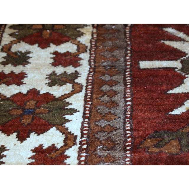 Handmade vintage Caucasian Eagle Kazak rug from the middle of 20th century. The rug has been made in USSR and it is in...