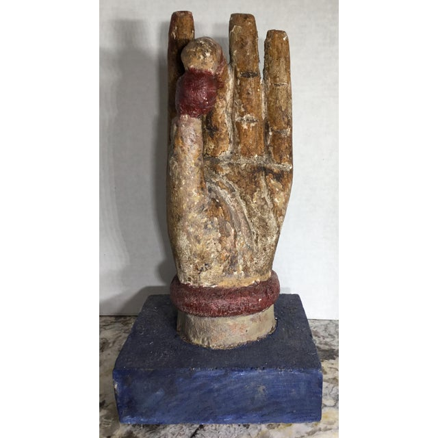 Elagent carving made of wood ,and hand painted of Buddha hand .this decorative piece went through time and element and...