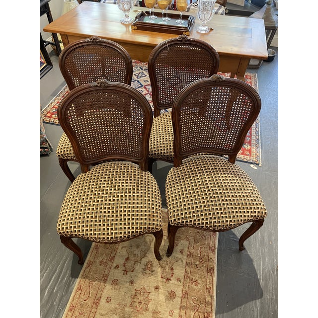 These are a beautiful set of French Country style chairs. The chairs feature cane backing, patterned cushions and...