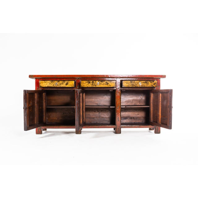 This gorgeous sideboard is from Gunsu, China and was made from pine wood, elmwood, and paint, circa 1920. The piece...