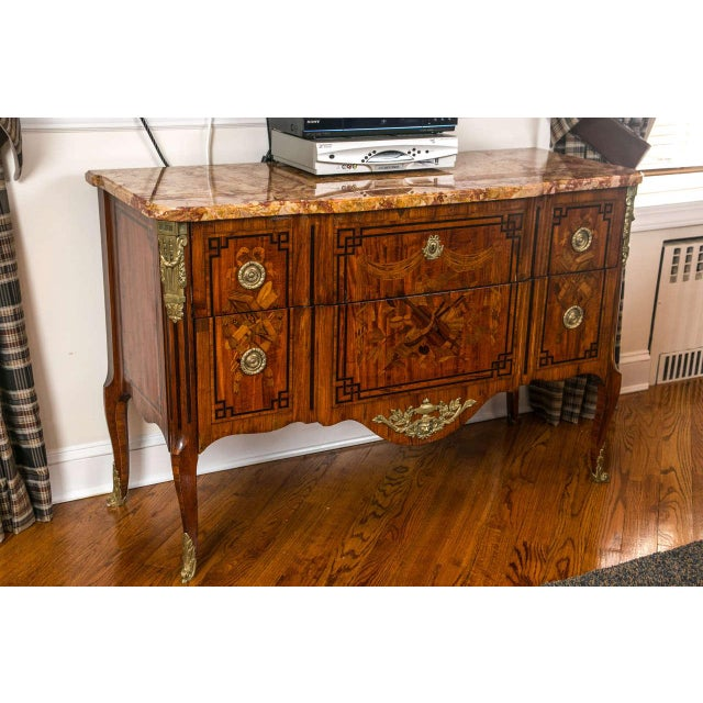 19th century large and impressive French marquetry commode. A finely detailed French commode. The fine burgundy, brown and...
