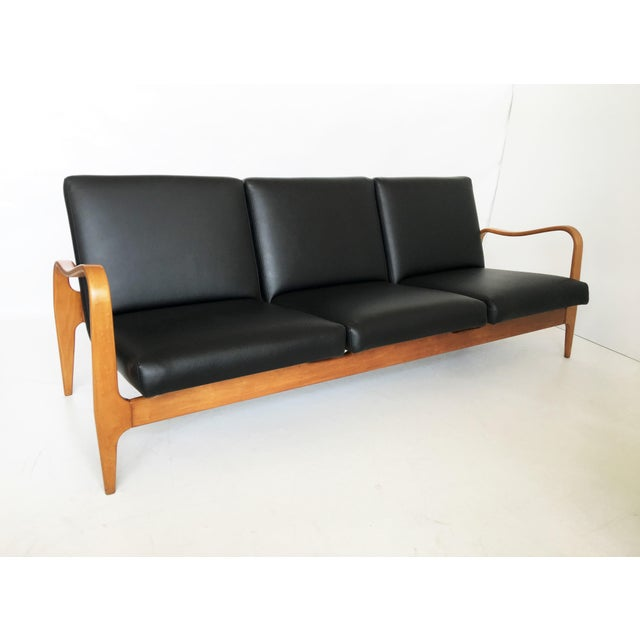 A great pair of vintage Thonet bentwood three-seat settee sofa couch. Features a super stylish organic curved line...