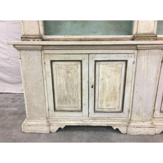 Spectacular 19th C Tuscan painted bookcase / display cabinet. This elegant piece was sourced out of Lucca, Italy and is...